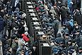 """Участники митинга """"За честные выборы"""" на улице Новый Арбат."""