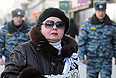 "Участница митинга ""За честные выборы"" на улице Новый Арбат."
