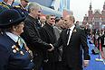 Мэр Москвы Сергей Собянин и президент РФ Владимир Путин во время военного Парада Победы на Красной площади.