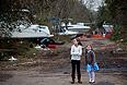 """Пессимисты указывают на то, что предварительные оценки обычно оказываются заметно меньше итоговых, как это было в случае с ураганами """"Катрина"""" и """"Айрин"""". PricewaterhouseCoopers в этой связи ожидает, что совокупный ущерб, нанесенный экономике, достигнет 45 млрд долларов."""