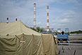 Палаточный лагерь для задержанных мигрантов в Иртышском проезде в Москве.