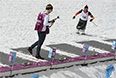 Спортсмены на огневом рубеже во время тренировки национальных сборных по биатлону перед началом XI зимних Паралимпийских игр в Сочи.