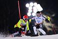 Валерий Редкозубов (Россия) и ведущий Евгений Героев (слева) на трассе слалома во второй попытке в классе B 1-3 (слабовидящие) на соревнованиях по горнолыжному спорту среди мужчин на XI Паралимпийских зимних играх в Сочи.
