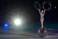 Артистка выступает во время театрализованного представления на церемонии закрытия XI зимних Паралимпийских игр в Сочи.