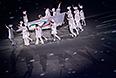 Церемония спуска Паралимпийского флага на церемонии закрытия XI зимних Паралимпийских игр в Сочи.