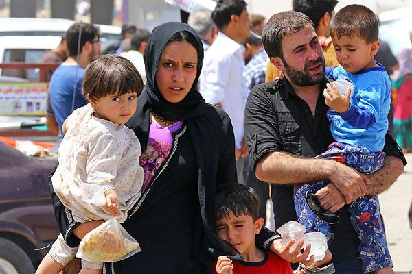 Семья беженцев из Мосула.