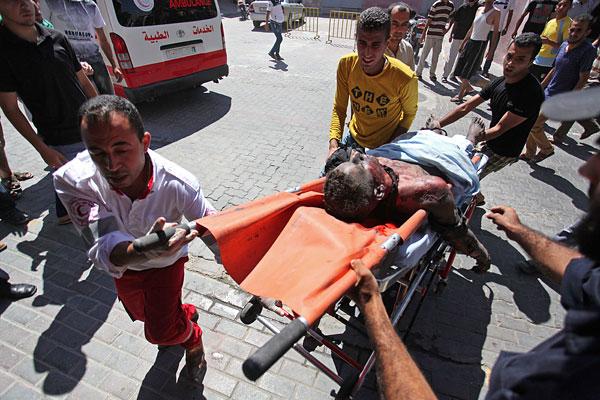 """Не менее 28 палестинцев погибли в секторе Газа в результате начатой Израилем операции """"Рубеж обороны""""."""