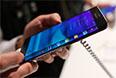 """Galaxy Edge, смартфон, отличительной особенностью которого является как бы """"стекший"""" на бок дисплей. На боковой экран устройства будут выводится уведомления, а также с его помощью можно будет получить быстрый доступ к часто используемым приложениям. Кроме того, он будет доступен даже тогда, когда основной дисплей смартфона занят другим приложением, например, фильмом или игрой."""