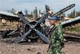 Боец народного ополчения на территории разрушенного аэропорта Луганска.