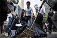 Офисные работники так же решили помочь с уборкой города после столкновений.