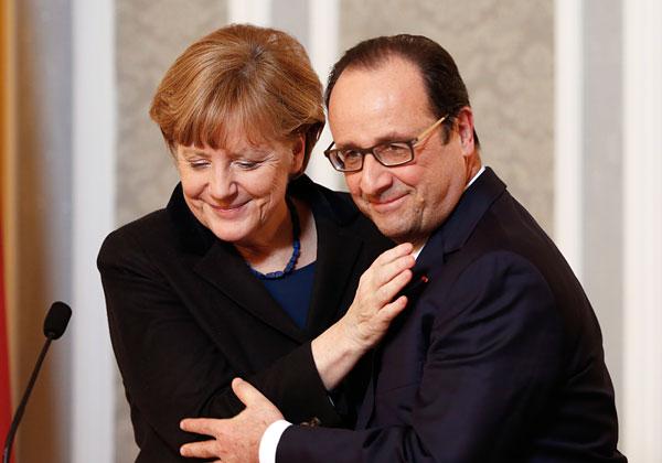 Ангела Меркель и Франсуа Олланд во время пресс-конференции по итогам переговоров в Минске