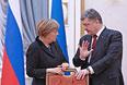 Канцлер Германии Ангела Меркель и президент Украины Петр Порошенко во время переговоров