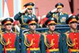 Министр обороны РФ Сергей Шойгу (слева на втором плане) во время военного парада на Красной площади