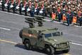 """Бронеавтомобиль """"Тигр"""" с противотанковым ракетным комплексом """"Корнет-Д"""" во время проезда военной техники"""
