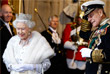 Королева Великобритании Елизавета II и ее супруг принц Филипп после торжественного открытия парламентской сессии в Вестминстерском дворце в Лондоне. 2013 год.