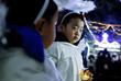 Дети во время рождественской мессы у собора Непорочного Зачатия в Пекине