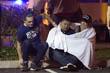 По словам очевидцев, одетый в черное мужчина, чье лицо было частично закрыто, выстрелил в человека, стоявшего у двери, а затем открыл огонь по посетителям бара.