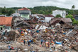 В результате стихийного бедствия оказались разрушены десятки домов, пострадали, в том числе здания туристических отелей