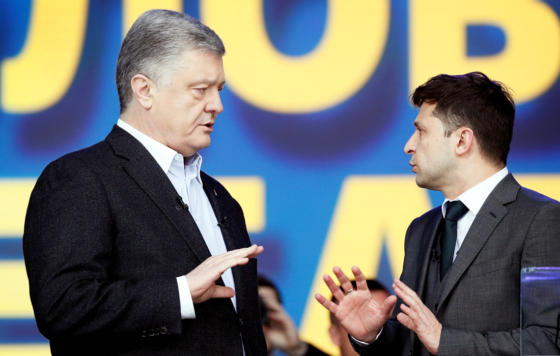 Кандидат в президенты Украины Петр Порошенко и его оппонент Владимир Зеленский