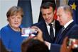 Четырехсторонней встрече лидеров предшествовали примерно получасовые двусторонние беседы Владимира Путина с  Ангелой Меркель и Эммануэлем Макроном