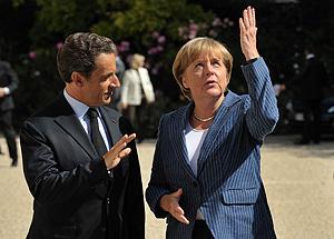 Меркель и Саркози спасают евро кнутом