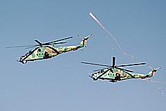 Боевые вертолеты проводят до Сирии