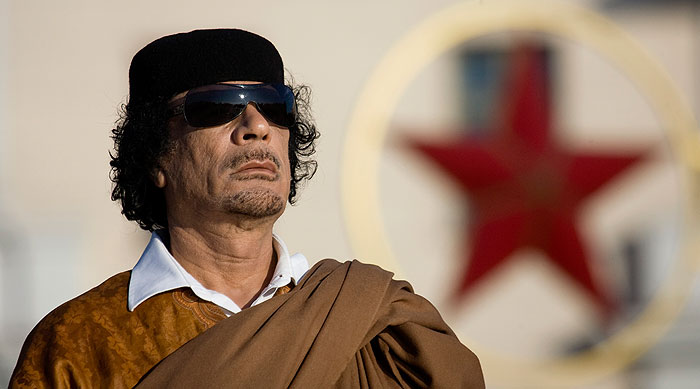 Вдова Каддафи требует показать ей могилу мужа
