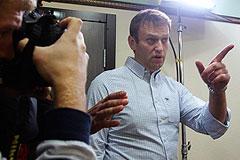 """Во время обыска по """"делу СПС"""" у Навального изъяли картину и военный билет"""