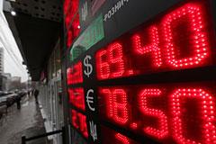 Доллар достиг 69 рублей на фоне геополитики и снижения цен на нефть