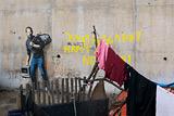 Бэнкси изобразил Джобса на стене в лагере беженцев в Кале