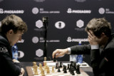Карякин сыграл вничью с Карлсеном во второй партии чемпионского матча