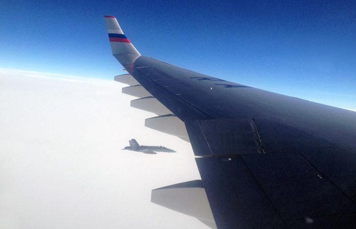 Борт Российской Федерации насаммит АТС вПеру сопровождали швейцарские истребители