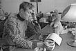 Евтушенко за работой у себя дома. Маленький кенгуру на его рабочем столе - память об Австралии. 1966 год,  Москва.
