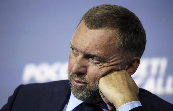 Дерипаска согласился сократить долю в En+ и уйти из совета директоров