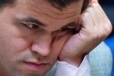 Норвежец Магнус Карлсен защитил титул чемпиона мира по шахматам