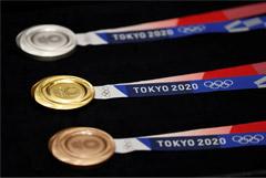 В Токио презентованы медали Олимпиады-2020, сделанные из переработанных гаджетов