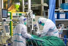 За сутки 42 человека умерли от коронавируса в китайской провинции Хубэй
