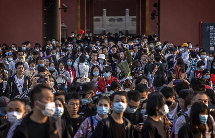 """Почти 500 млн китайцев разъехались по стране во время """"золотой недели"""""""