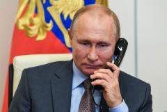 Путин обсудил с Меркель возможность совместного производства COVID-вакцин
